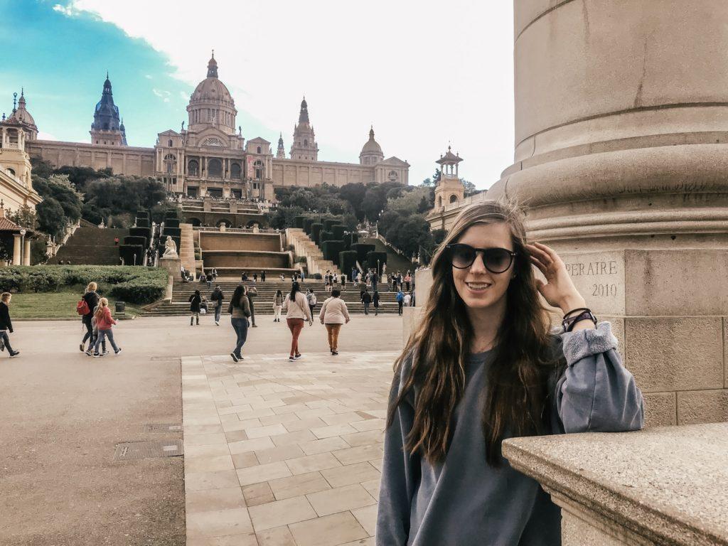 Girl in front of Catalunya Museum in Espanya Square Barcelona