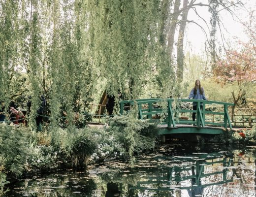 Girl on green bridge at Giverny