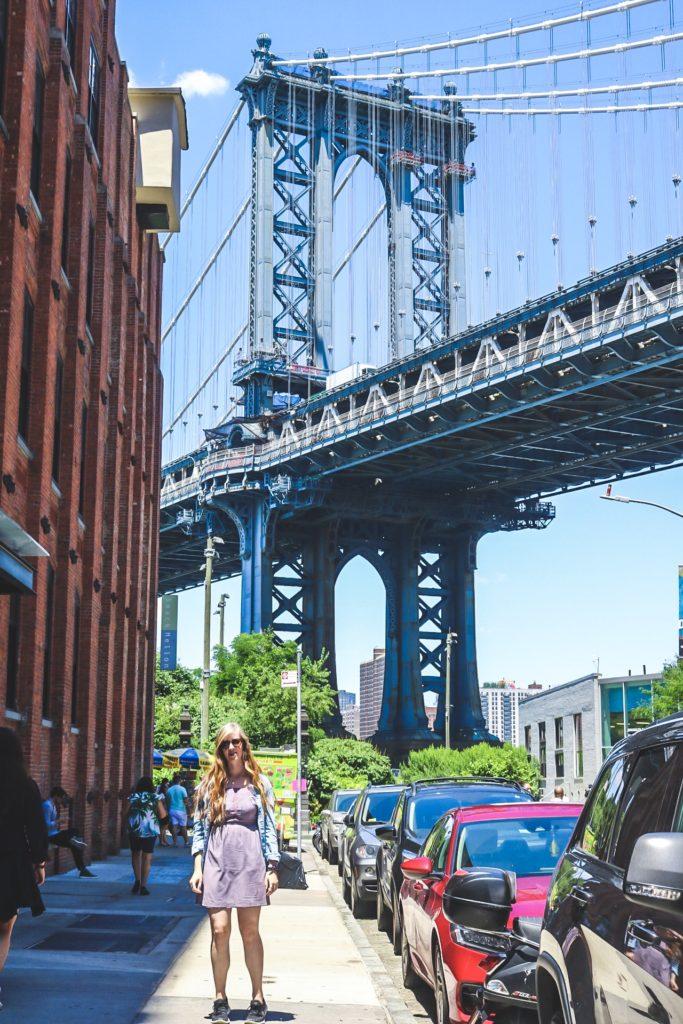 Girl in front of Brooklyn Bridge NYC