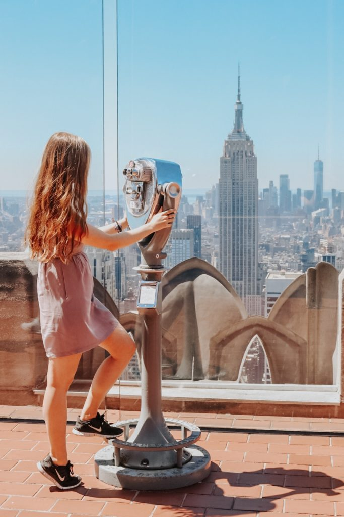 Girl viewing NYC skyline at Top of the Rock NYC