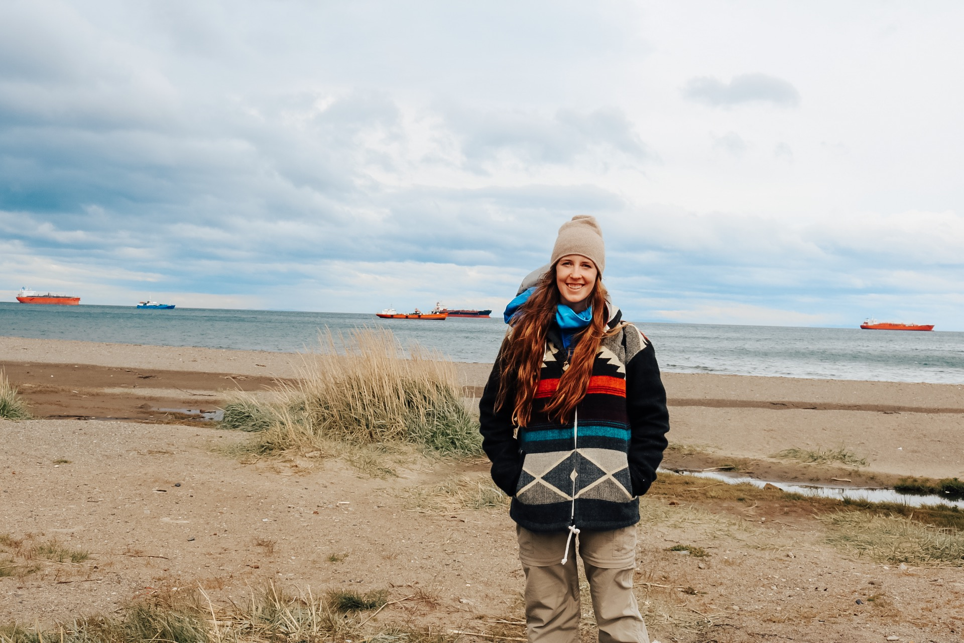 girl in front of Magellan Strait beach in Punta Arenas Chile