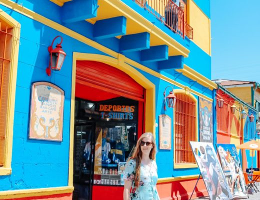 girl walking in colorful La Boca neighborhood in Buenos Aires Argentina