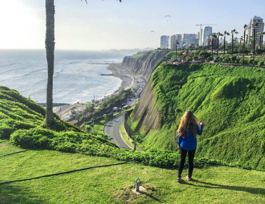girl in front of cliffs and boardwalk in Lima Peru